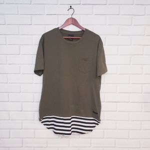 Green tee with black and white striped bot…